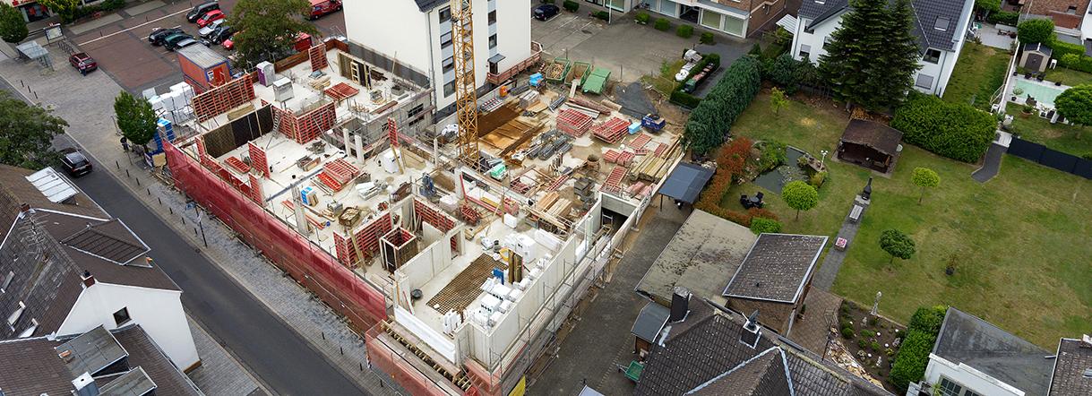 Neubau eines Mehrfamilienhauses mitten im Ortskern von Niederkassel
